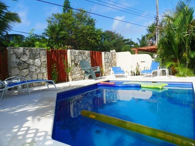 Private Swimming pool with lounge chairs