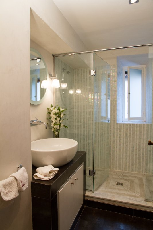 Family bathroom with large shower cabin and window