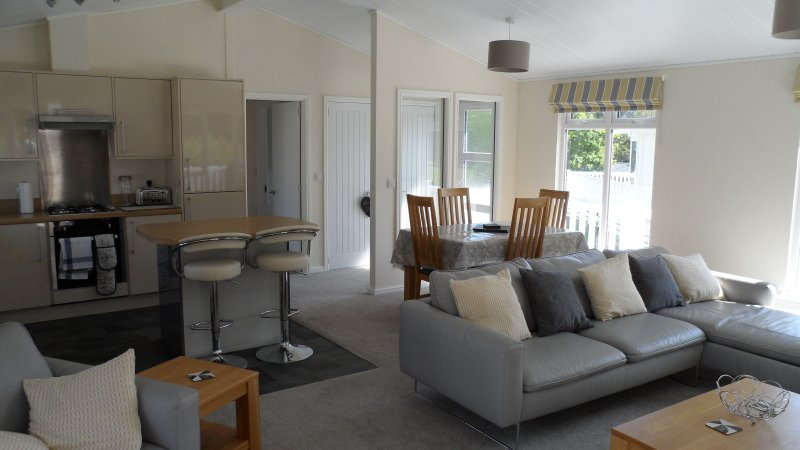Open plan living area with dining table and 4 chairs