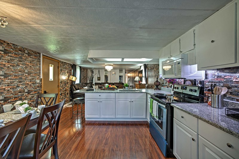 Cook tasty meals in the fully equipped kitchen with stainless steel appliances.