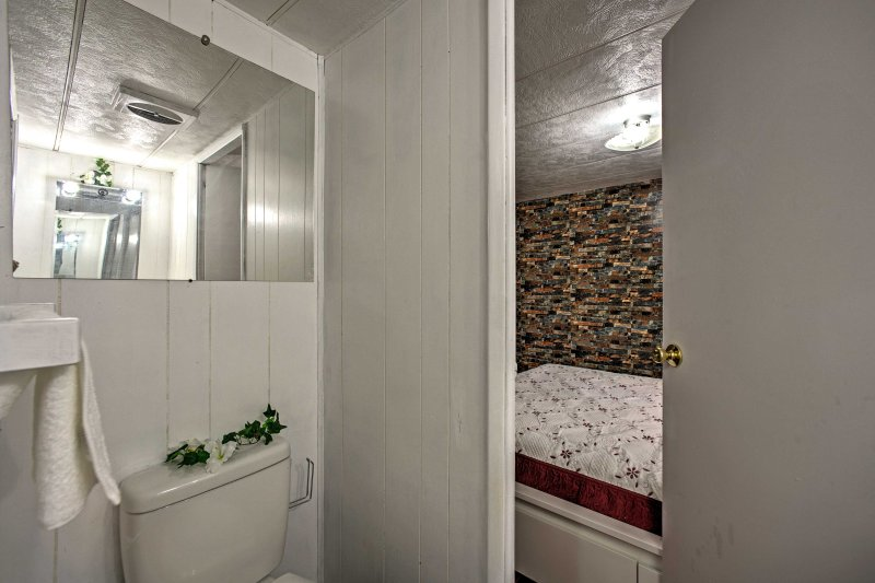 The en-suite bathroom offers privacy while you get read.