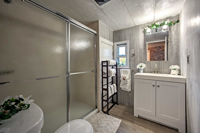The bathroom offers a walk-in shower.