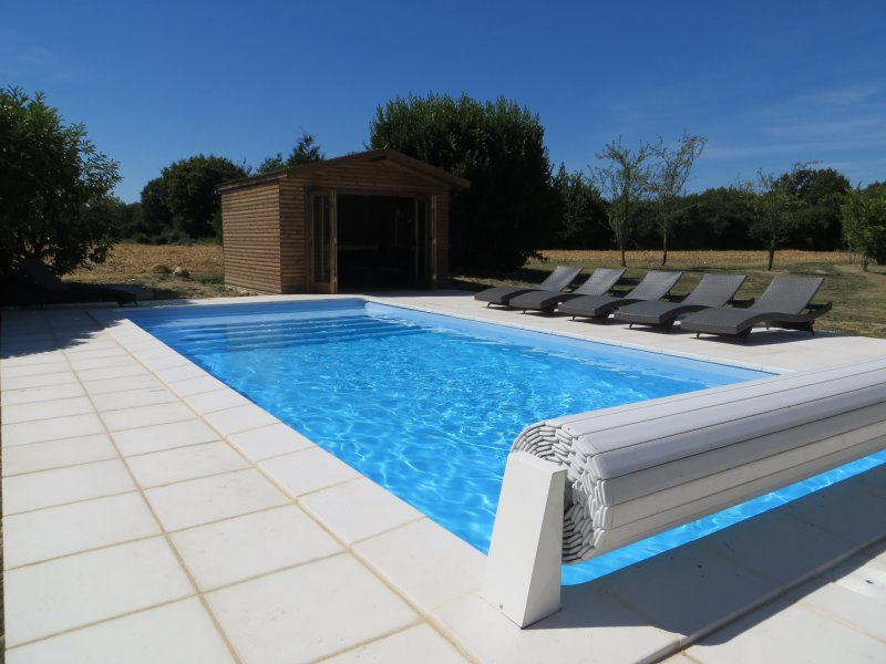 Large heated swimming pool (9m x4m) with large south facing terrace and luxury reclining sunbeds.