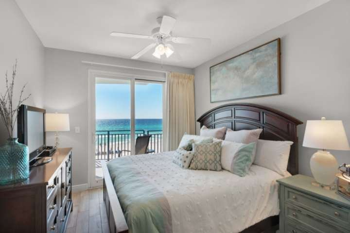 Master bedroom with a king sized bed and balcony access.