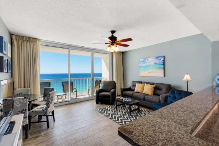 Large living room with new tile floors, queen sleeper sofa and great views!