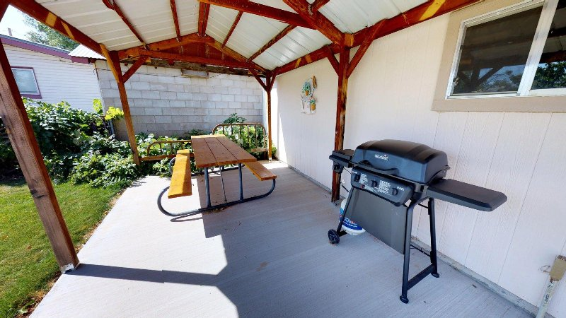 BBQ and outdoor dining area