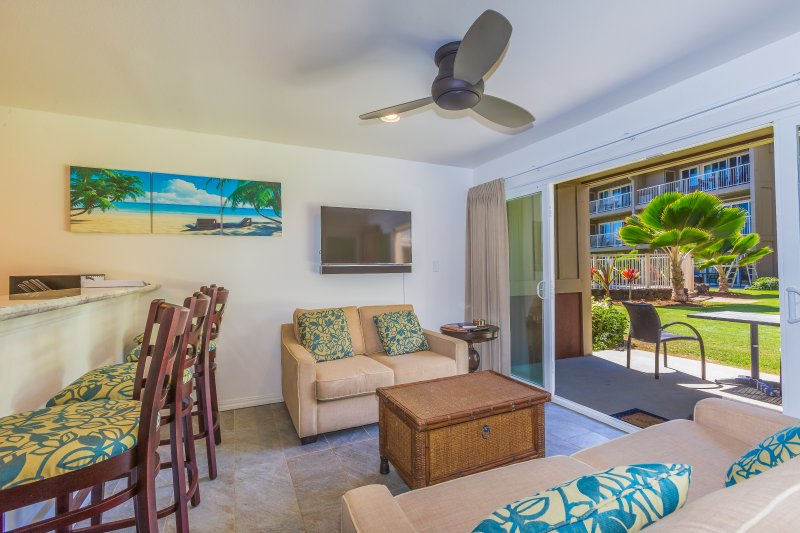 Living room with ceiling fan and open up to Lanai for wonderful living space.