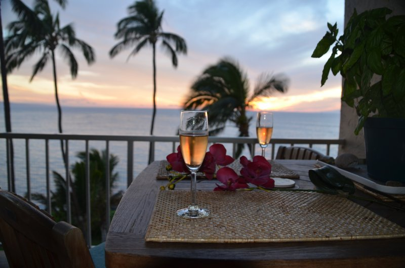 Toast the sunset from the lanai -Aloha