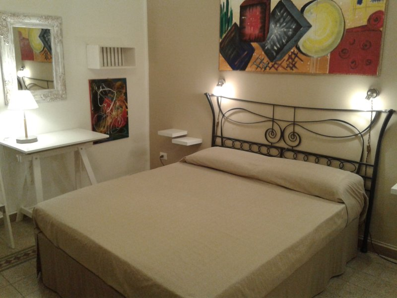 Double bed in the first bedroom.