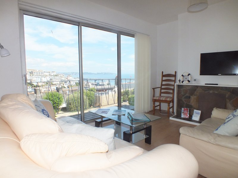 The panoramic view from the living area on the middle floor over the bay ,harbour and town.