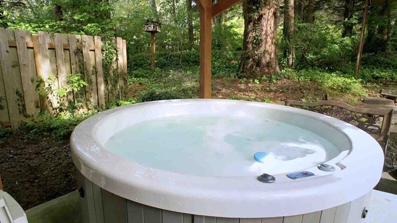 Soak up serenity and relaxation in the private hot-tub.