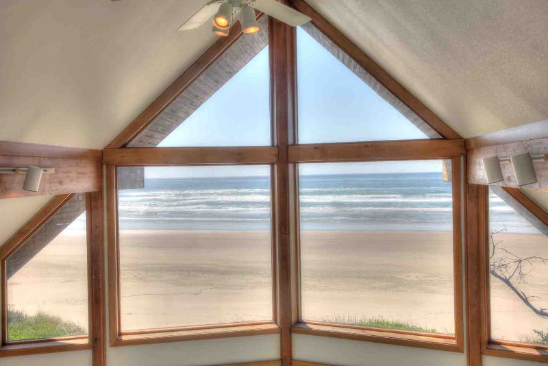 Watch the waves from the master bedroom loft.