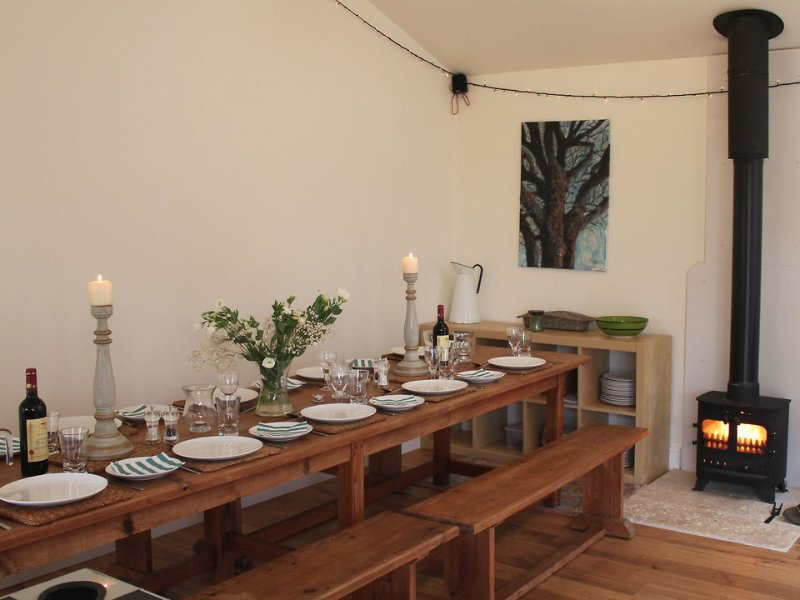 The refectory table in the communal barn provides seating for 10