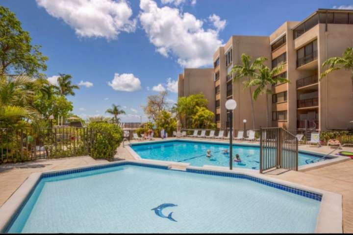 Large fenced in sundeck with both a family friendly kiddie pool and full size adult pool.