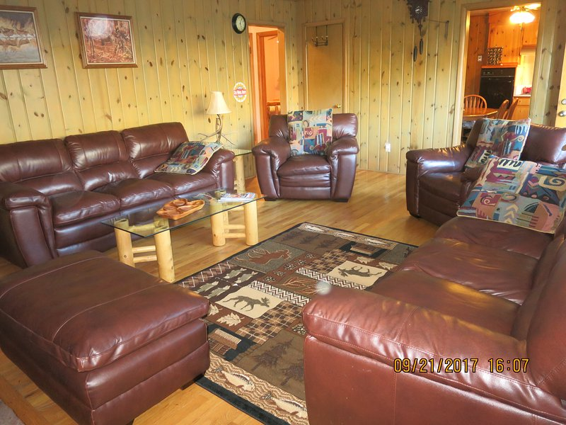 LIVING ROOM HAS 2 SETS OF LEATHER FURNITURE