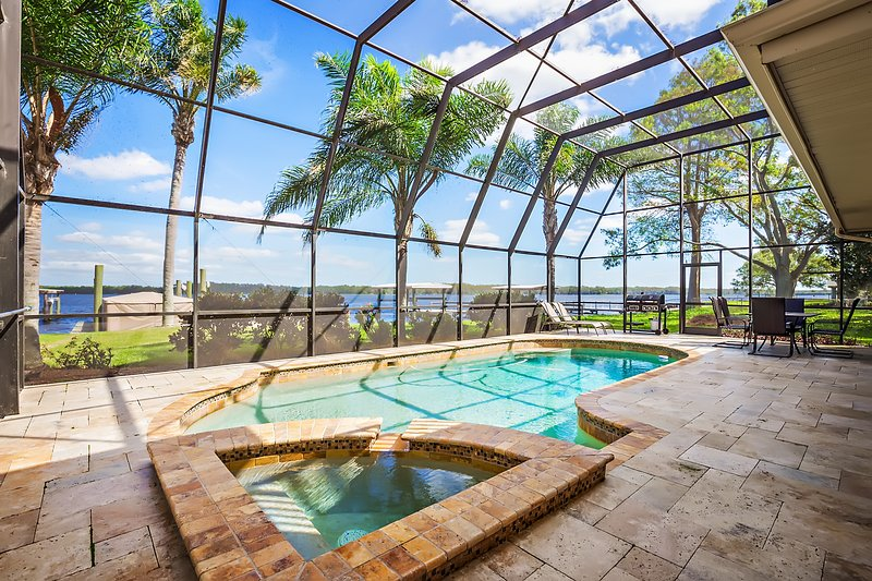 Beautiful Sunrise on Lake Tarpon and the lake side pool. Visit Florida Sun Vacation Rentals!