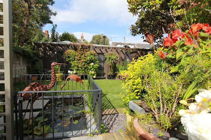 View shared garden, pond, water features, sculptures, self contained studio