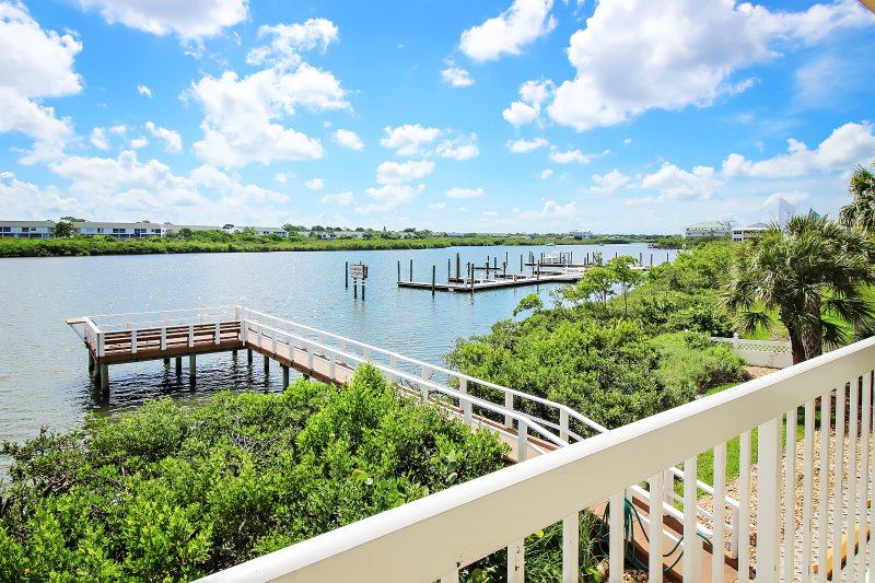 Sit on the deck and watch the boats go by with a breeze as dolphins and manatees play below
