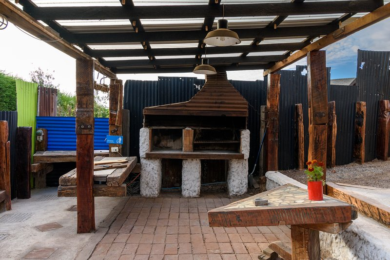 Roofed barbecue area. We have fire, Kanka, swords and lamb pot curanto