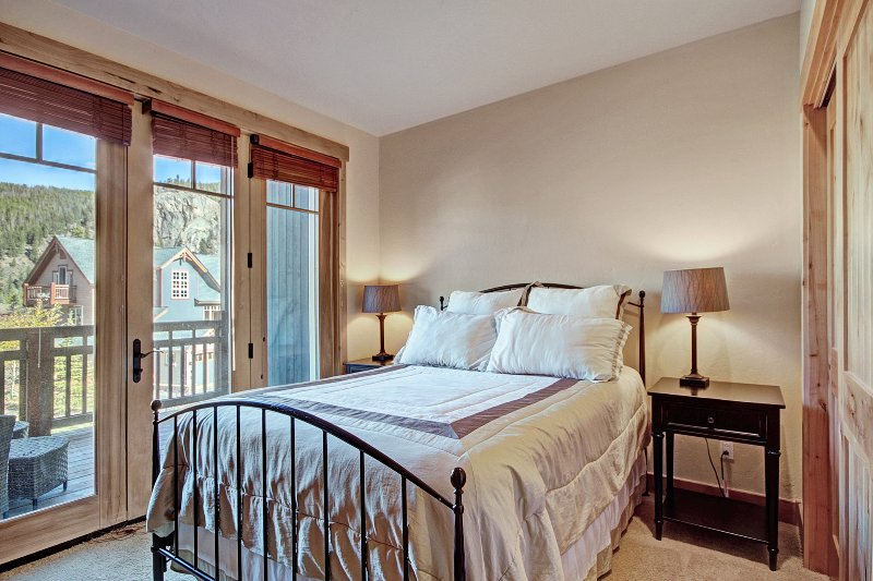 Guest Bedroom - This bedroom features a queen-sized bed and a patio.