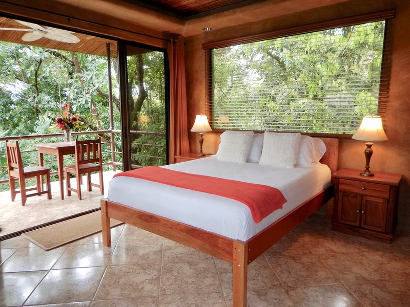 Slide open the glass doors to your private balcony, have a seat and relax to sounds of the jungle.
