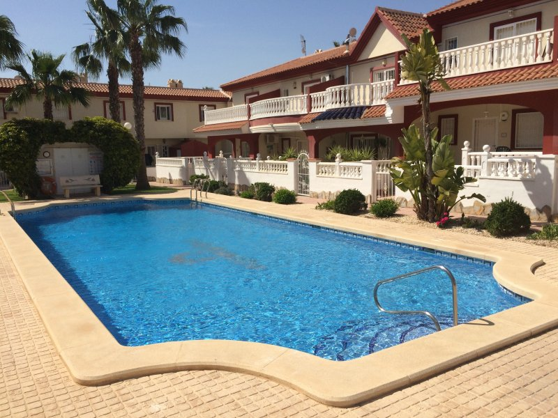 Our lovely shared pool with our villa, Casa Balsol, behind it