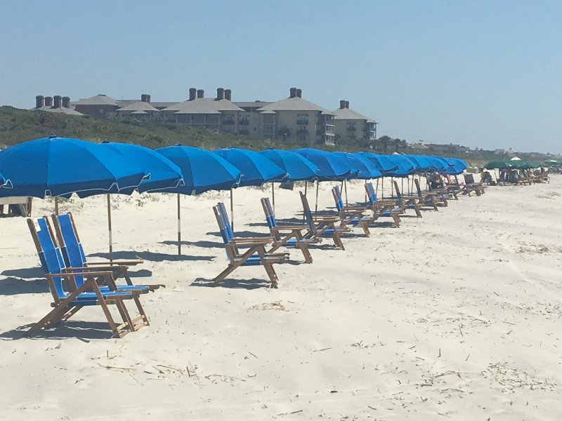 View of Beach and Chairs That Can Be Rented Through Resort