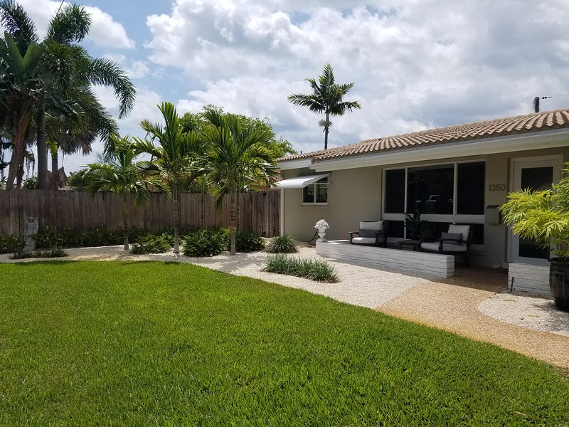 Our home is beautifully landscaped with tropical palms and flowering plants.