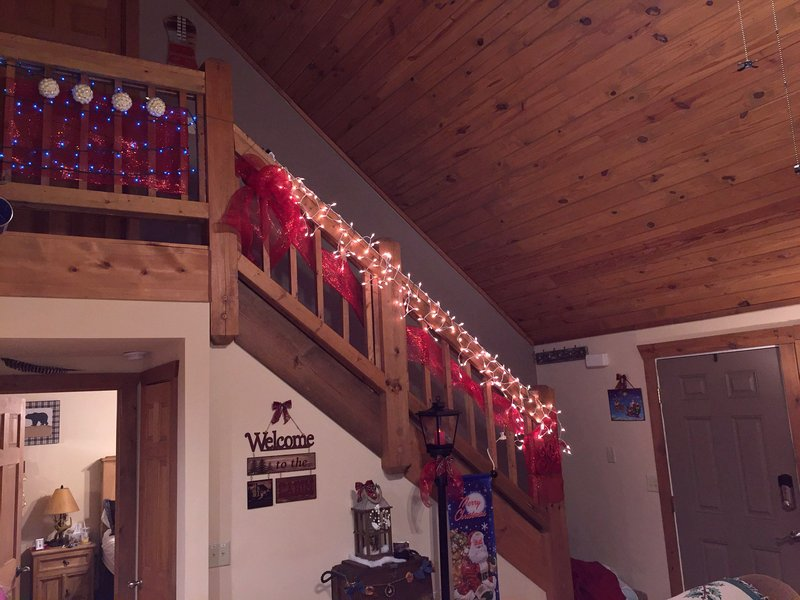 Staircase banister with Christmas lights