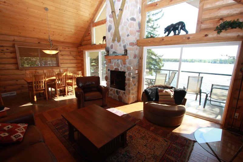 Glass window wall shows incomparable view of Lake Delton year round. Features electric fireplace.