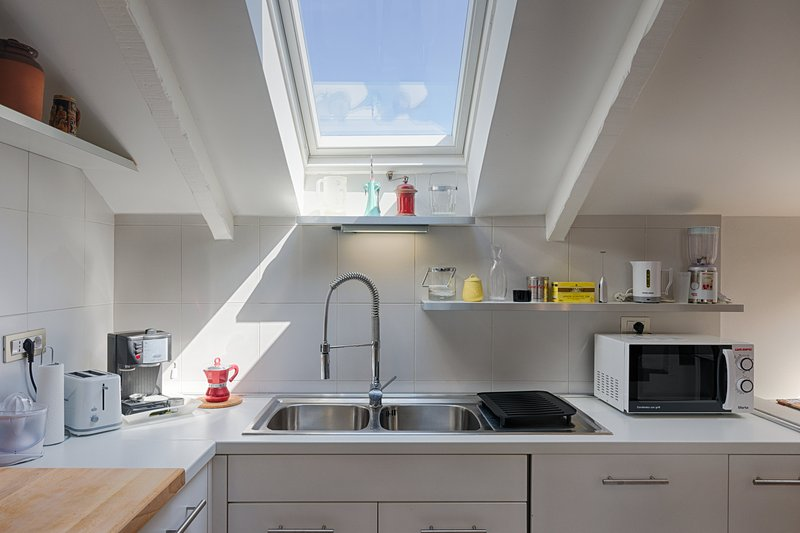 The kitchen is equipped with microwave, coffee machine, toaster, kettle and dishwasher.