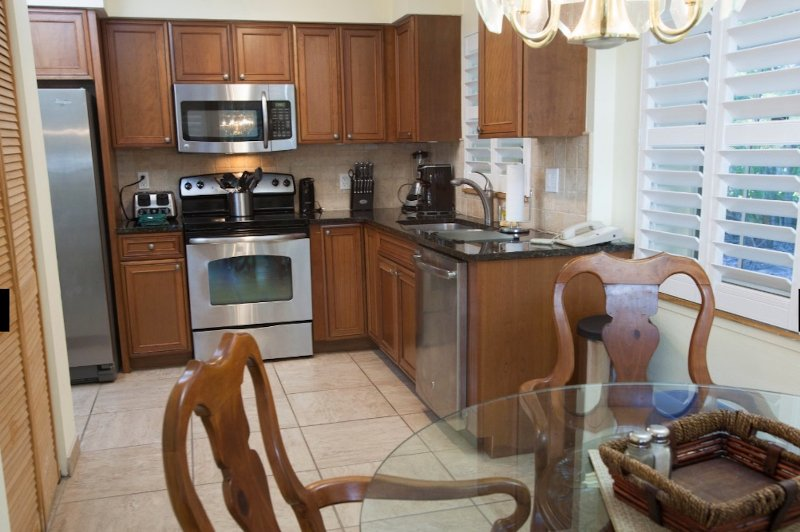 full kitchen with large and small appliances.  Includes all utensils, cookware and eating supplies.