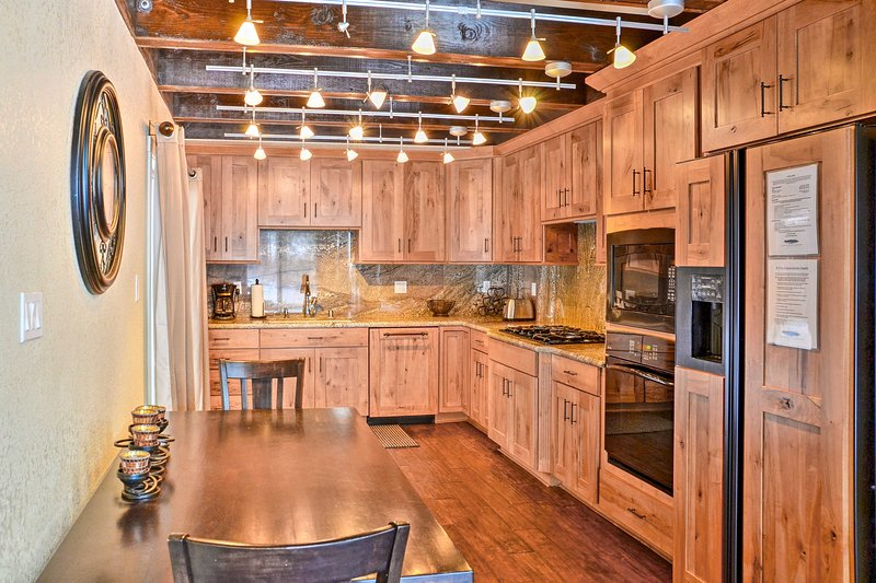 The exposed beams and granite backsplash make for a pleasant cooking experience!