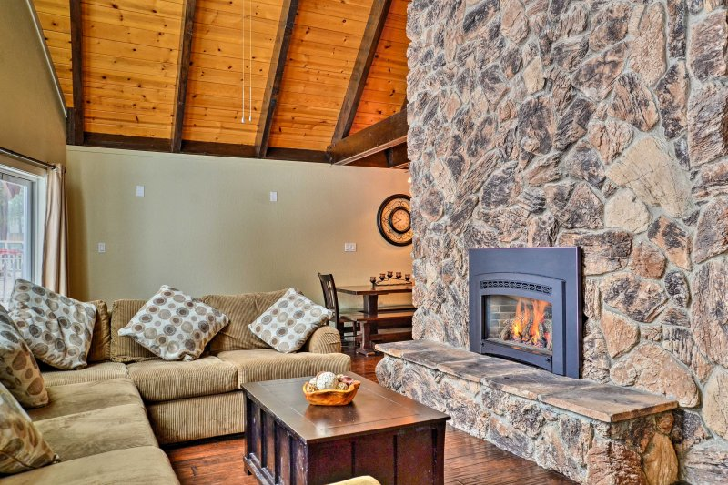 Warm up by this floor-to-ceiling rock fireplace after skiing.