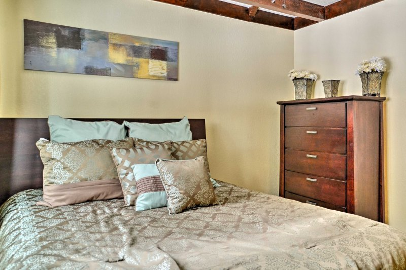 Two other travelers can get a peaceful night's slumber in this downstairs bedroom.