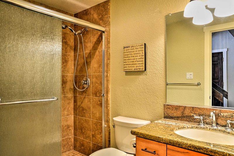 Enjoy a refreshing rinse in this full bathrooms walk-in shower.