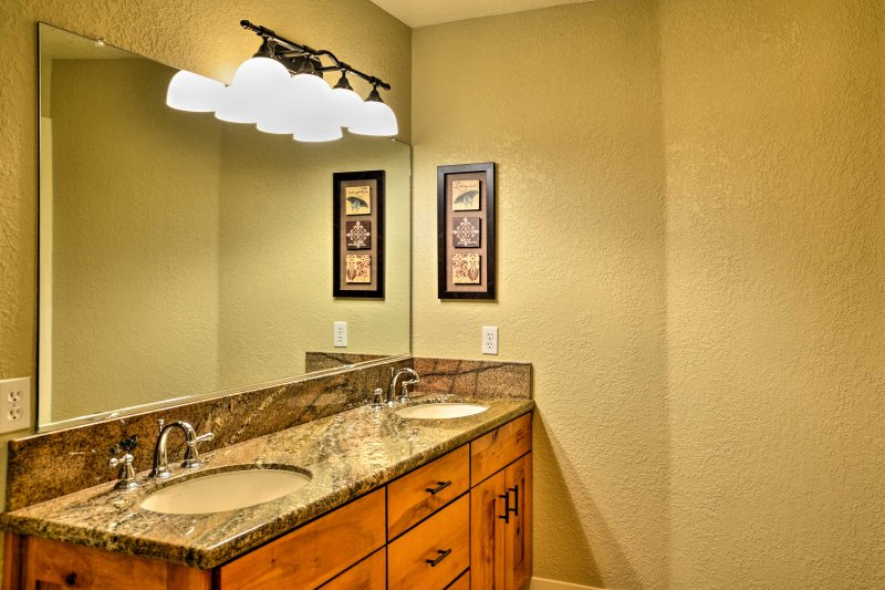 This bathroom offers a double vanity and large walk-in shower.