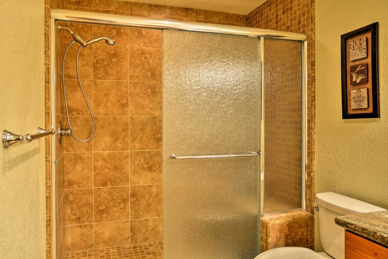 Rinse off the day in the walk-in shower.