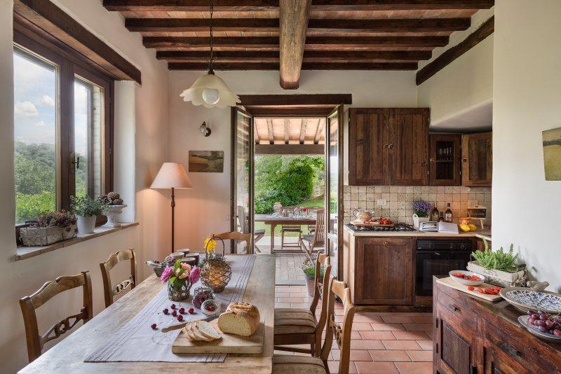 Kitchen dining room with door leading onto veranda