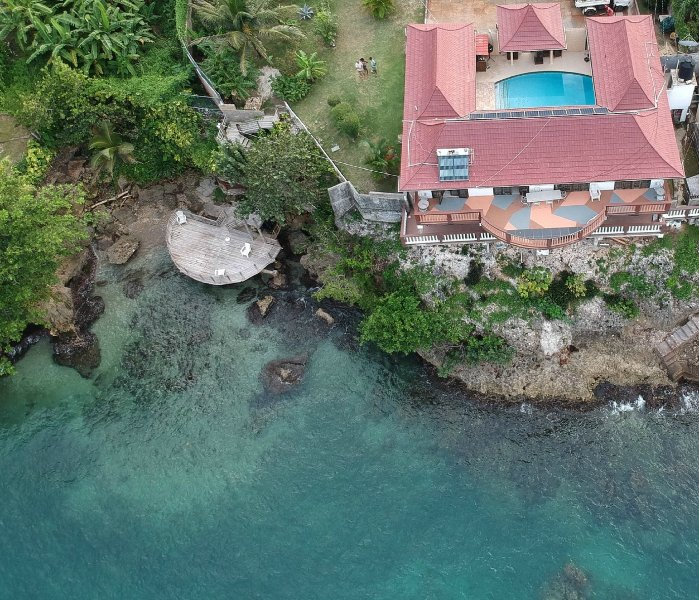 Aerial view of Oceanfront Villa, with Sundeck and access into the sea, great for snorkeling!