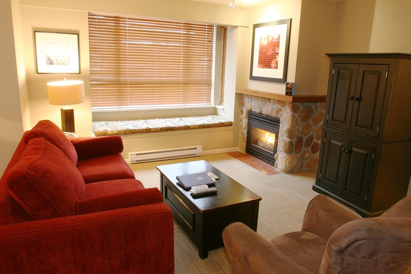 Relax in front of the beautiful stone fireplace after a day on the slopes