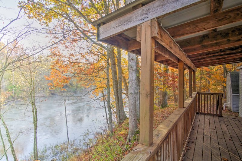 Wake up to the sounds of Muskegon River rushing by when you stay at this vacation rental cabin in Fremont!