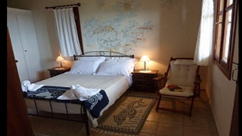 bedroom with doublebed and own wc/shower