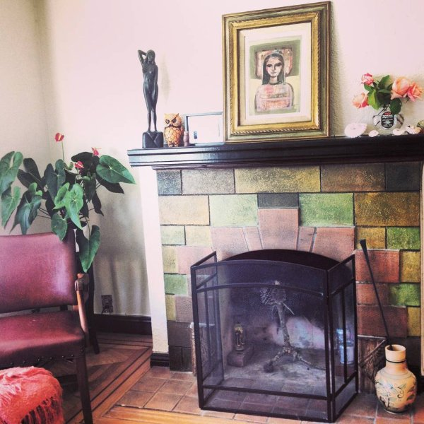 Original fireplace in the living room from the 1920s