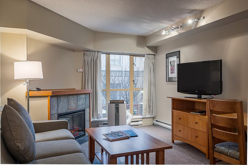 Sit back and enjoy watching a movie on the flat screen TV in the living area.