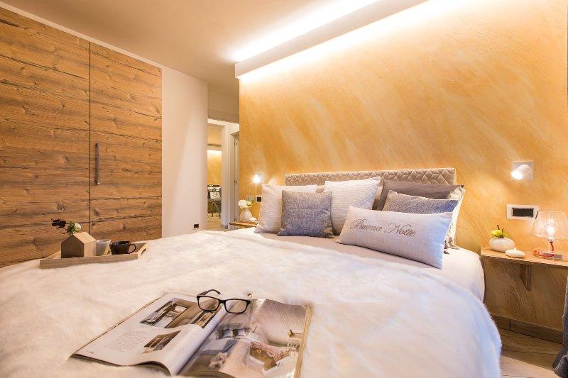 Camera da letto dell'appartamento di Pozza di Fassa
