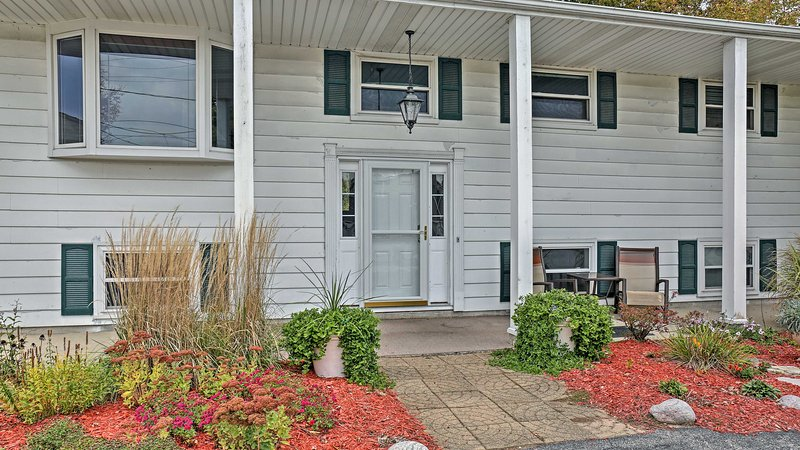 The front patio is beautifully landscaped and sets the mood for your getaway!
