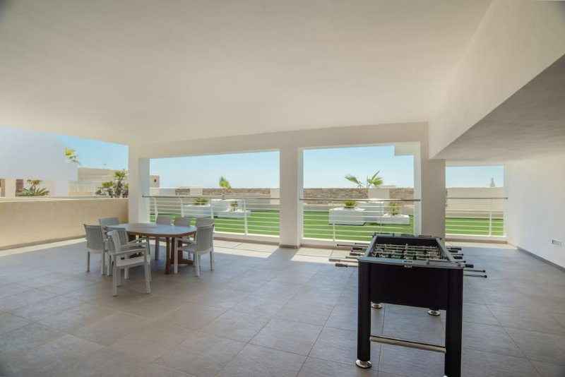 Ground Floor Terrace equipped with table and chairs and table soccer