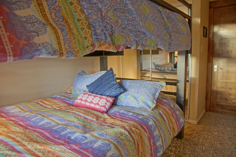 Bedroom 3 has 2 Queen beds with colorful new bedding