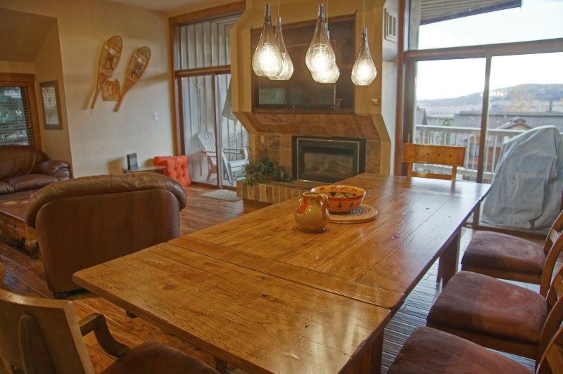 The dining area adjoins the living room and deck